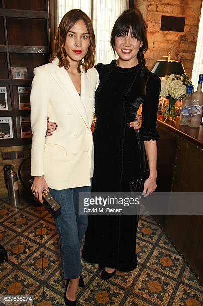 Alexa Chung and Daisy Lowe attend The Fashion Awards in partnership with Swarovski nominees' lunch hosted by the British Fashion Council with Grey...