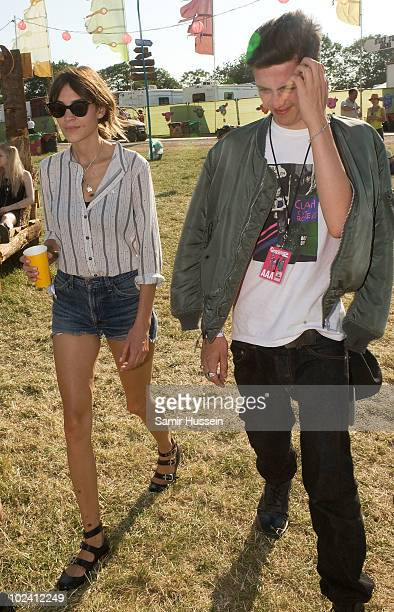 Alexa Chung and guest attend the Glastonbury Festival on June 25 2010 in Glastonbury England Glastonbury has become Europe's largest music festival...
