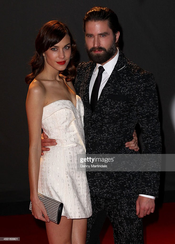 Alexa Chung and Jack Guinness attend the British Fashion Awards 2013 at London Coliseum on December 2, 2013 in London, England.
