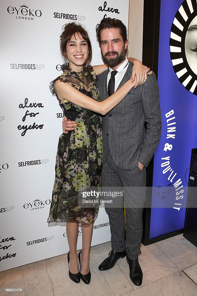 Alexa Chung and Jack Guinness attend the launch of Alexa Chung's new eyeliner and mascara set for Eyeko at Selfridges on November 14, 2013 in London, England.