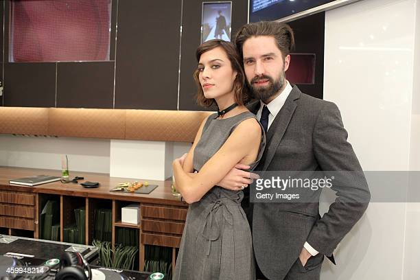 Alexa Chung and Jack Guinness attend the Longchamp Elysees 'Lights on Party' Boutique Launch on December 4 2014 in Paris France
