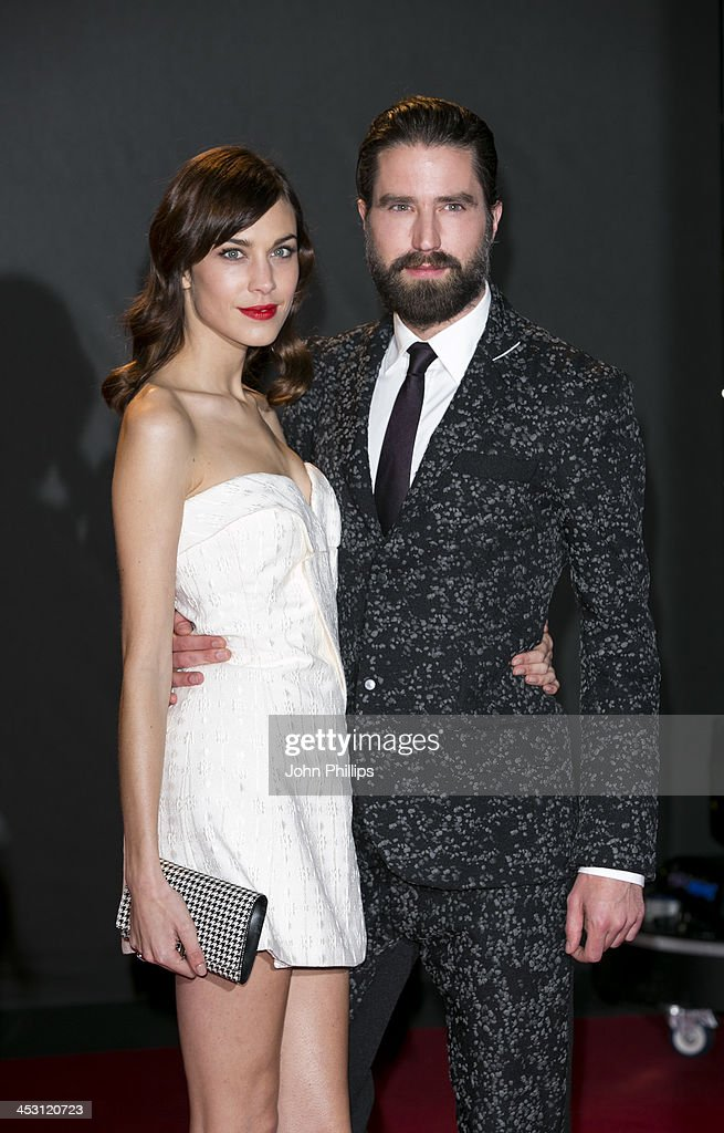 Alexa Chung and Jack Guinness attends the British Fashion Awards 2013 at London Coliseum on December 2, 2013 in London, England.