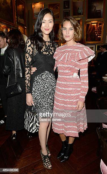 Alexa Chung and Liu Wen attend the The Business Of Fashion #BoF500 Gala Dinner Party at The London EDITION Hotel on September 21 2015 in London...