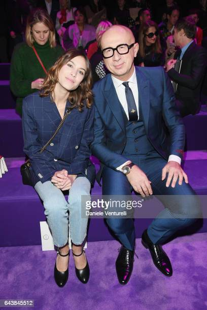 Alexa Chung and Marco Bizzarri attend the Gucci show during Milan Fashion Week Fall/Winter 2017/18 on February 22 2017 in Milan Italy