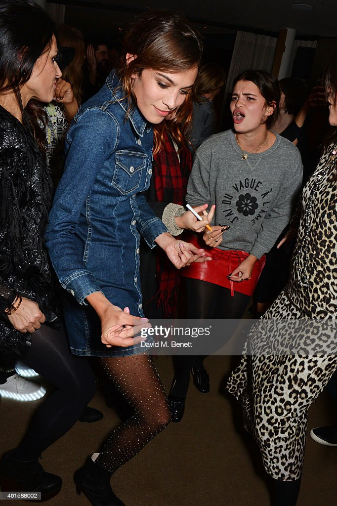 Alexa Chung (L) and Pixie Geldof attend an intimate party hosted by Alexa Chung to celebrate the global launch of the Alexa Chung for AG collection at Neo Bankside on January 15, 2015 in London, England.