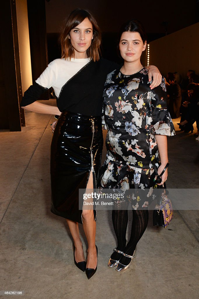 Alexa Chung and Pixie Geldof attend the Christopher Kane show during London Fashion Week Fall/Winter 2015/16 at Tate Modern on February 23 2015 in...