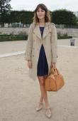 Alexa Chung arrives for the Chloe Ready to Wear Spring/Summer 2011 show during Paris Fashion Week at Espace Ephemere Tuileries on October 4 2010 in...