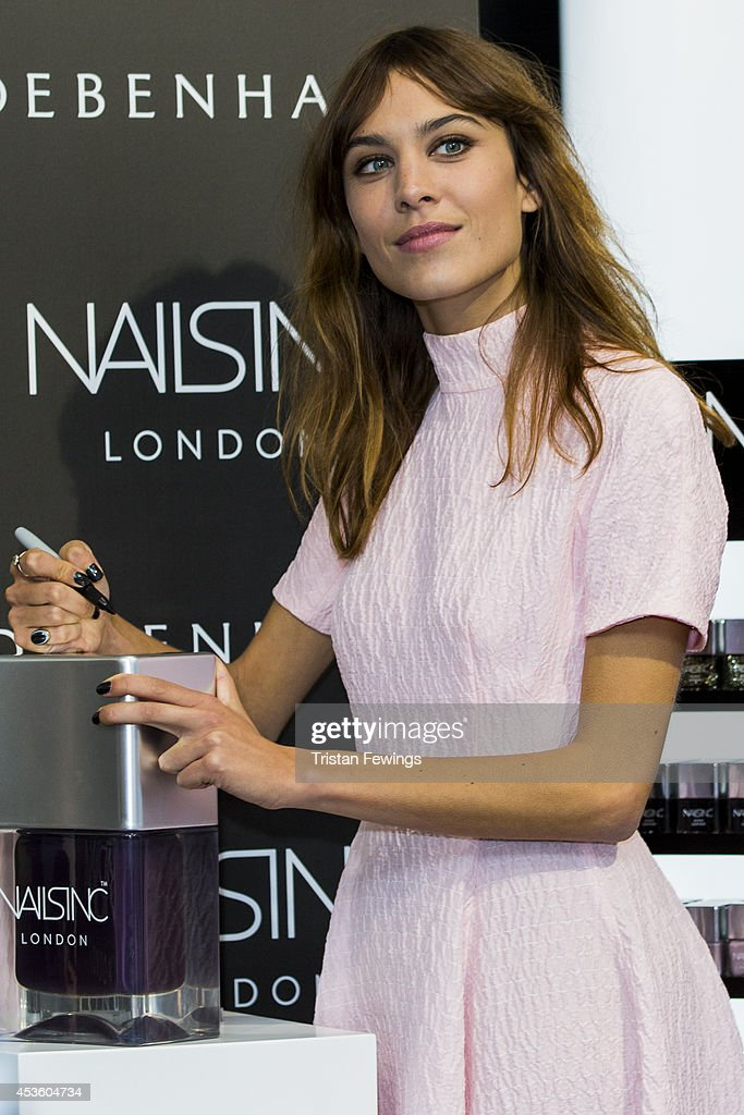 Alexa Chung attends a photocall to launch her Alexa Manicure collection with Nails Inc at Debenhams on August 14, 2014 in London, England.