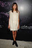 Alexa Chung attends Christian Siriano's celebration of his new fragrance with a Stoli Vodka cocktail at the designer's popup Silhouette Shoppe in the...