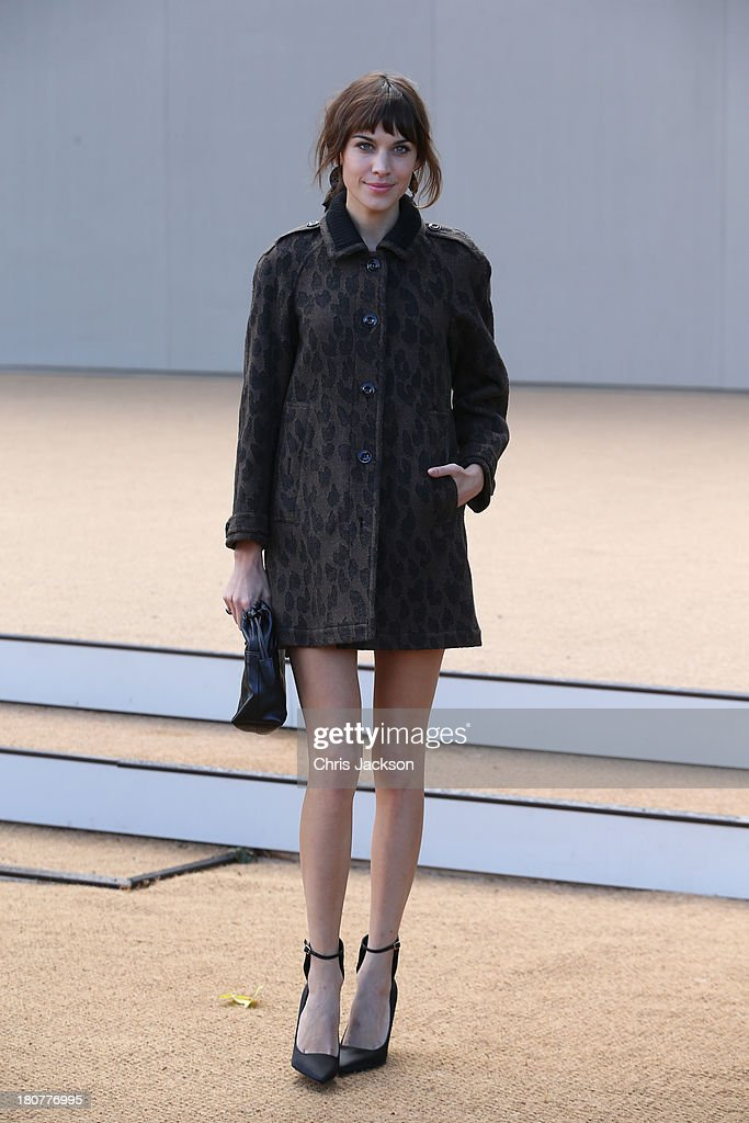 Alexa Chung attends the Burberry Prorsum show at London Fashion Week SS14 at Kensington Gardens on September 16, 2013 in London, England.