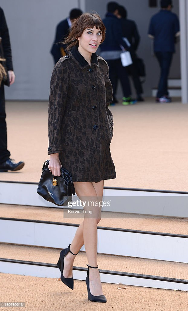 Alexa Chung attends the Burberry Prorsum show during London Fashion Week SS14 at Kensington Gardens on September 16, 2013 in London, England.