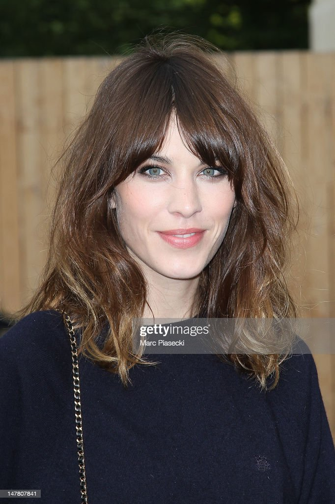 <a gi-track='captionPersonalityLinkClicked' href=/galleries/search?phrase=Alexa+Chung&family=editorial&specificpeople=3141821 ng-click='$event.stopPropagation()'>Alexa Chung</a> attends the Chanel Haute-Couture Show as part of Paris Fashion Week Fall / Winter 2013 at Grand Palais on July 3, 2012 in Paris, France.