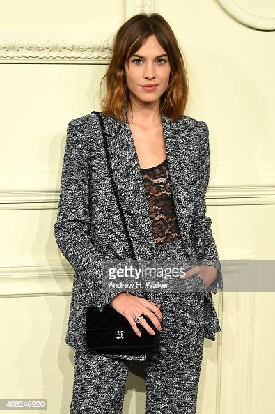 Alexa Chung attends the CHANEL ParisSalzburg 2014/15 Metiers d'Art Collection in New York City at the Park Avenue Armory on March 31 2015 in New York...