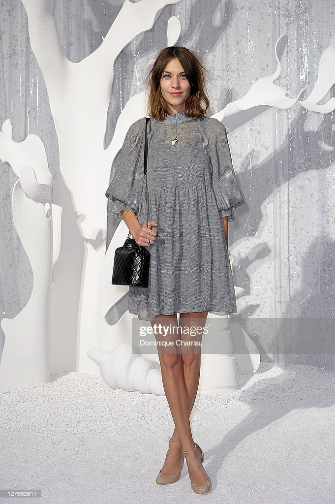 Alexa Chung attends the Chanel Ready to Wear Spring / Summer 2012 show during Paris Fashion Week at Grand Palais on October 4 2011 in Paris France