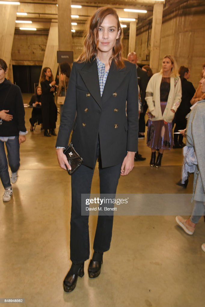 Alexa Chung attends the Christopher Kane SS18 catwalk show during London Fashion Week September 2017 at The Tanks at Tate Modern on September 18, 2017 in London, England.