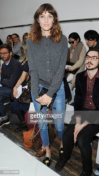 Alexa Chung attends the front row for the Margaret Howell show on day 3 of London Fashion Week Spring/Summer 2013 at Margaret Howell on September 16...