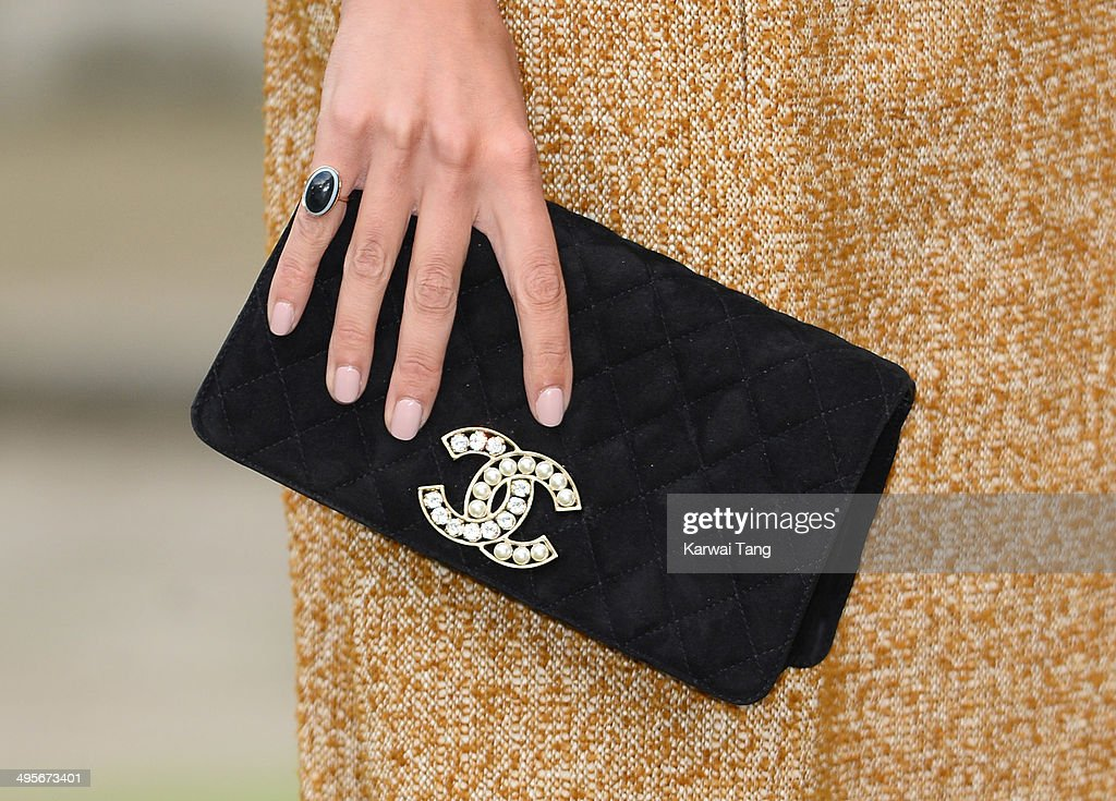Alexa Chung (Bag detail) attends the Royal Academy Summer Exhibition Preview Party at the Royal Academy of Arts on June 4, 2014 in London, England.