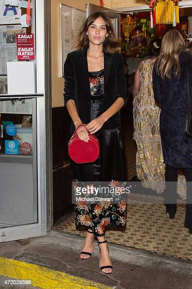 Alexa Chung attends the Voguecom Dim Sum Pajama Party at Nom Wah Tea Parlor on May 2 2015 in New York City