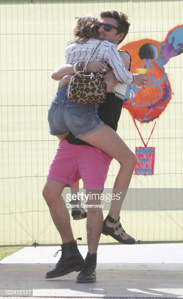 Alexa Chung embraces Henry Holland backstage at Glastonbury Festival at Worthy Farm Pilton on June 25 2010 in Glastonbury England This year sees the...