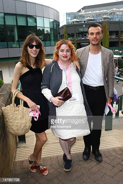Alexa Chung Fifi Brown and Theo Hutchcraft pose for photos outside the Evian Suite at Wimbledon at Wimbledon on June 28 2012 in London England