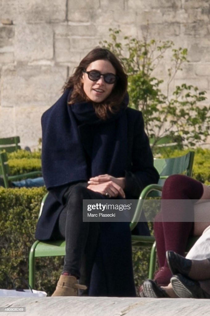 Alexa Chung (L) is seen in the 'Jardins des Tuileries' on March 27, 2014 in Paris, France.