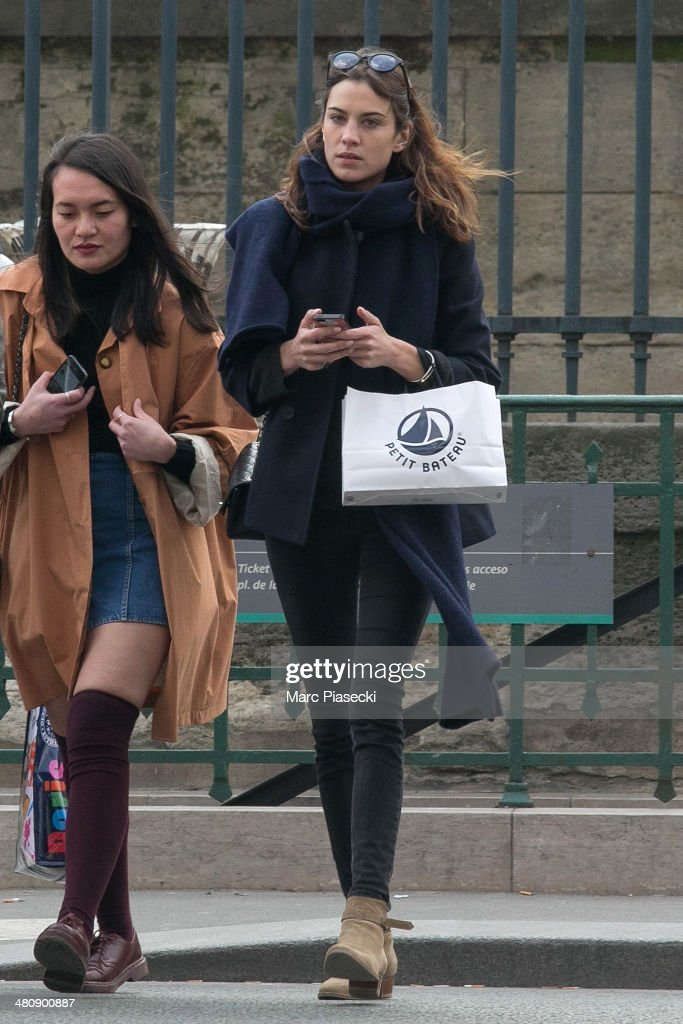 <a gi-track='captionPersonalityLinkClicked' href=/galleries/search?phrase=Alexa+Chung&family=editorial&specificpeople=3141821 ng-click='$event.stopPropagation()'>Alexa Chung</a> (R) is seen leaving the 'Jardins des Tuileries' on March 27, 2014 in Paris, France.