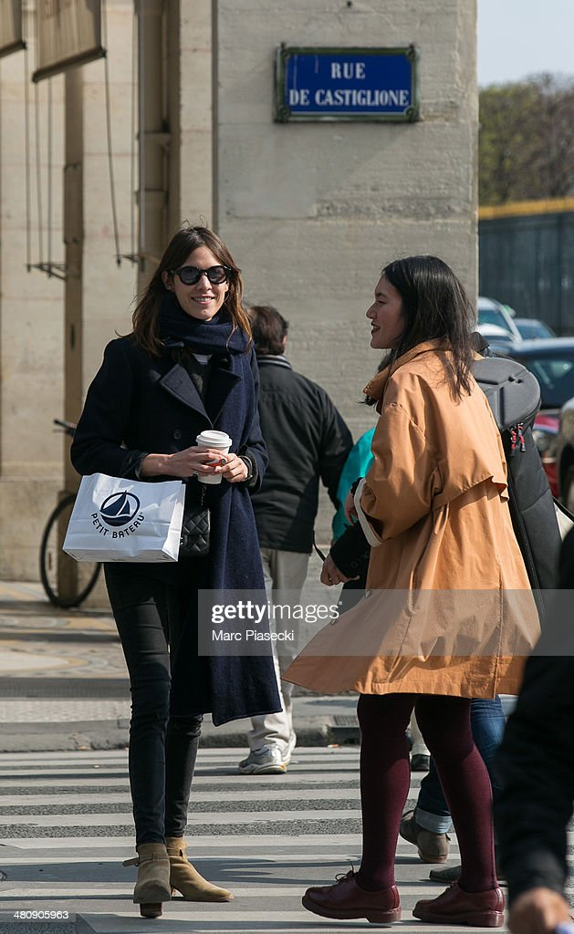 <a gi-track='captionPersonalityLinkClicked' href=/galleries/search?phrase=Alexa+Chung&family=editorial&specificpeople=3141821 ng-click='$event.stopPropagation()'>Alexa Chung</a> (L) is seen strolling on the 'Rue de Castiglione' on March 27, 2014 in Paris, France.