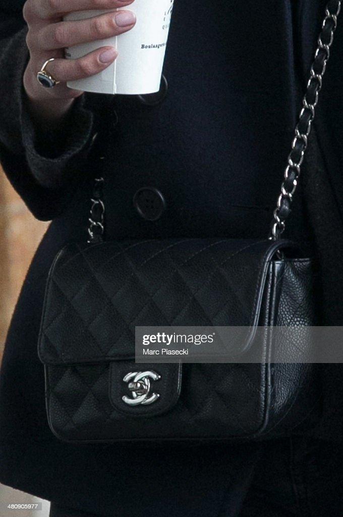 Alexa Chung (Chanel handbag detail) is seen strolling on the 'Rue de Rivoli' on March 27, 2014 in Paris, France.