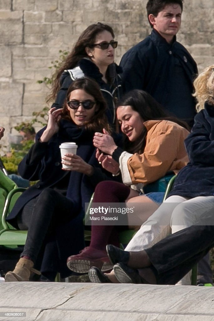 Alexa Chung (L) is seen with a friend in the 'Jardins des Tuileries' on March 27, 2014 in Paris, France.