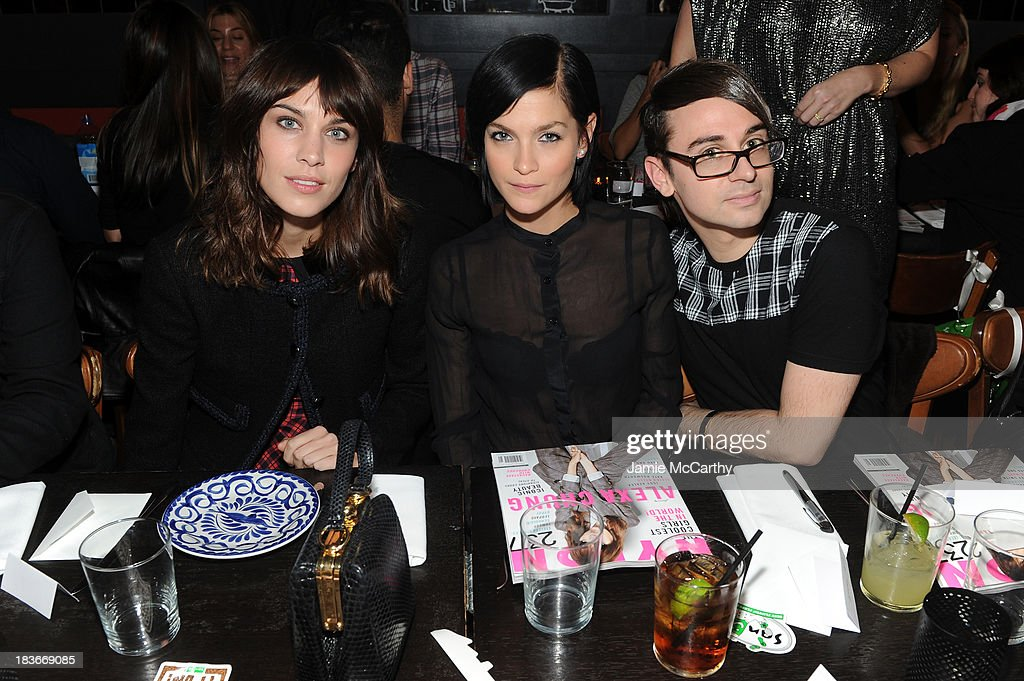 Alexa Chung, model Leigh Lezark and designer Christian Siriano attend NYLON + Sanuk celebrate the October 'It Girl' issue with cover star Alexa Chung at La Cenita on October 8, 2013 in New York City.