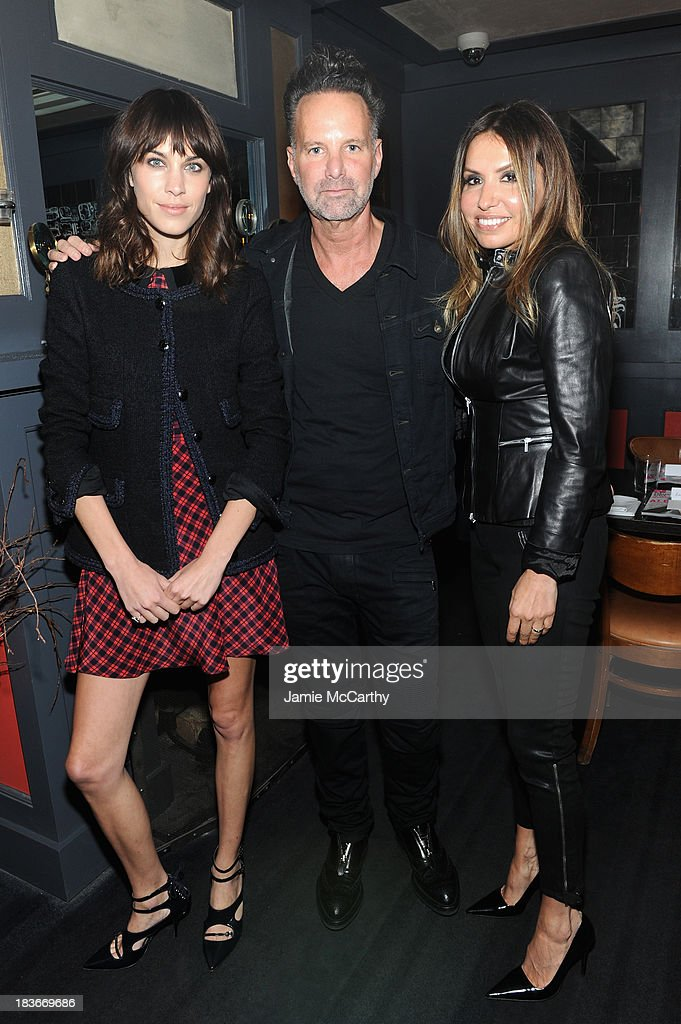 <a gi-track='captionPersonalityLinkClicked' href=/galleries/search?phrase=Alexa+Chung&family=editorial&specificpeople=3141821 ng-click='$event.stopPropagation()'>Alexa Chung</a>, Nylon Editor-in-Chief <a gi-track='captionPersonalityLinkClicked' href=/galleries/search?phrase=Marvin+Scott+Jarrett&family=editorial&specificpeople=859907 ng-click='$event.stopPropagation()'>Marvin Scott Jarrett</a> and Nylon Publisher Jaclynn Jarrett attend NYLON + Sanuk celebrate the October 'It Girl' issue with cover star <a gi-track='captionPersonalityLinkClicked' href=/galleries/search?phrase=Alexa+Chung&family=editorial&specificpeople=3141821 ng-click='$event.stopPropagation()'>Alexa Chung</a> at La Cenita on October 8, 2013 in New York City.