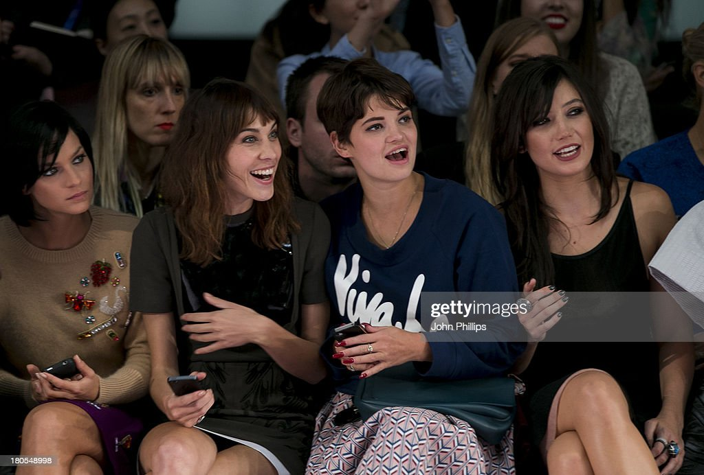 Alexa Chung, Pixie Geldof and Daisy Lowe attend the House Of Holland show during London Fashion Week SS14 on September 14, 2013 in London, England.