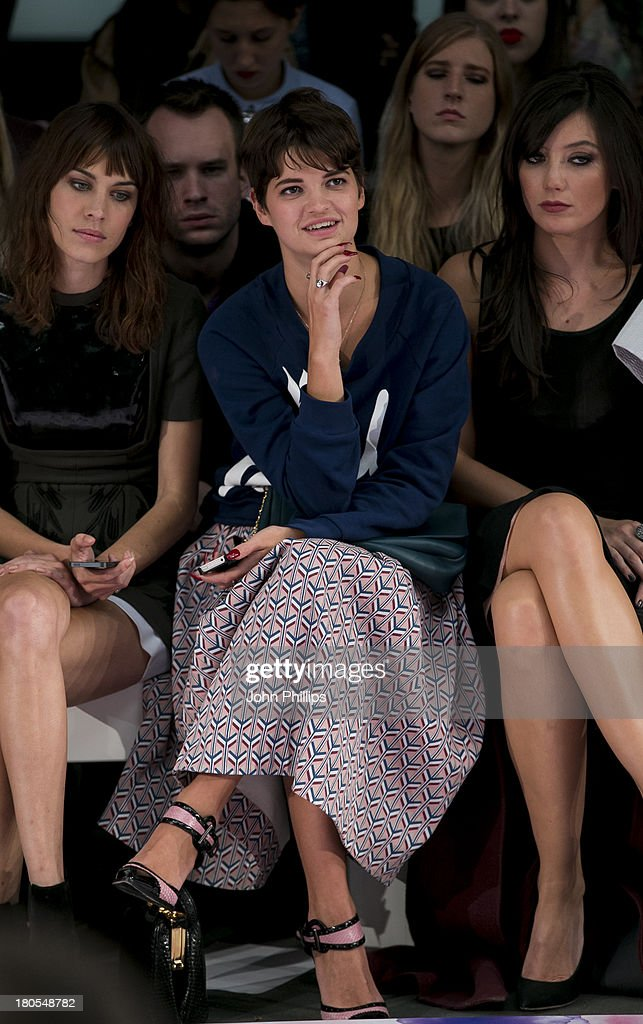 Alexa Chung, Pixie Geldof and Daisy Lowe attends the House Of Holland show during London Fashion Week SS14 on September 14, 2013 in London, England.