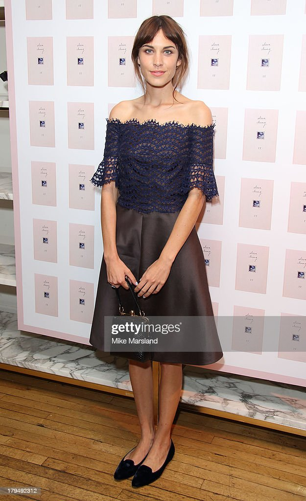 Alexa Chung poses for photographs as she celebrates the launch of her first book 'It' at Liberty on September 4, 2013 in London, England.
