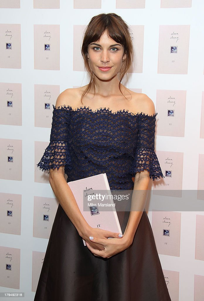<a gi-track='captionPersonalityLinkClicked' href=/galleries/search?phrase=Alexa+Chung&family=editorial&specificpeople=3141821 ng-click='$event.stopPropagation()'>Alexa Chung</a> poses for photographs as she celebrates the launch of her first book 'It' at Liberty on September 4, 2013 in London, England.