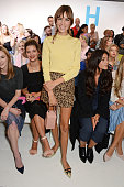Alexa Chung poses in front of Laura Carmichael Pixie Geldof and Jessie Ware at the Topshop Unique SS15 Front Row on September 14 2014 in London...