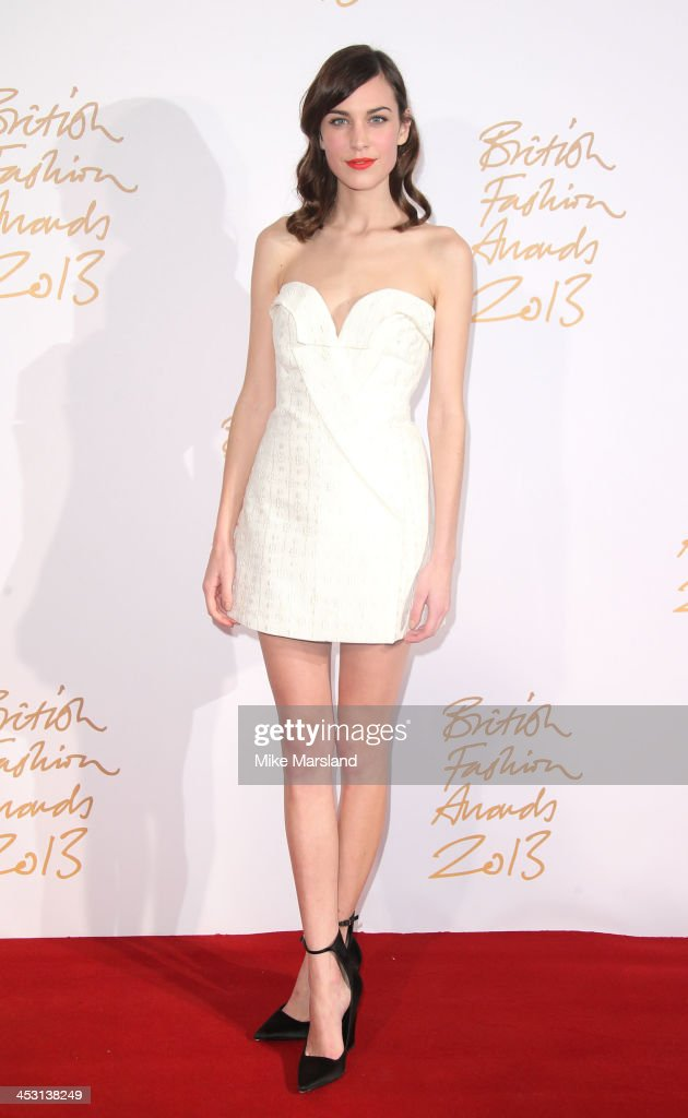 <a gi-track='captionPersonalityLinkClicked' href=/galleries/search?phrase=Alexa+Chung&family=editorial&specificpeople=3141821 ng-click='$event.stopPropagation()'>Alexa Chung</a> poses in the winners room at the British Fashion Awards 2013 at London Coliseum on December 2, 2013 in London, England.