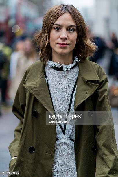Alexa Chung wearing an olive trench coat seen outside Erdem during London Fashion Week Autumn/Winter 2016/17 on February 22 2016 in London England...