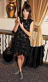 Alexa Chung winner of the British Style award supported by Vodafone poses with award at the British Fashion Awards 2012 at The Savoy Theatre on...