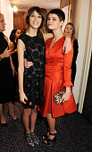 Alexa Chung winner of the British Style award supported by Vodafone and presenter Pixie Geldof poses at the British Fashion Awards 2012 at The Savoy...
