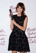 Alexa Chung winner of the British Style award supported by Vodafone poses in the awards room at the British Fashion Awards 2012 at The Savoy Hotel on...