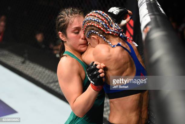 Alexa Grasso of Mexico pushes Felice Herrig up against the cage in their women's strawweight bout during the UFC Fight Night event at the Toyota...