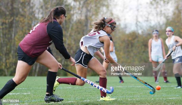 Alexa Koenig moves the ball while Kelsey Williams follows play during a Freeport High School field hockey practice