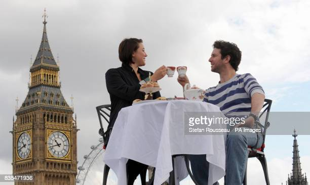 Alexa Mardon and Sean McConaghy enjoy tea on the roof of Westminster Abbey during a photocall commissioned by Visit London for the 'Only In London'...