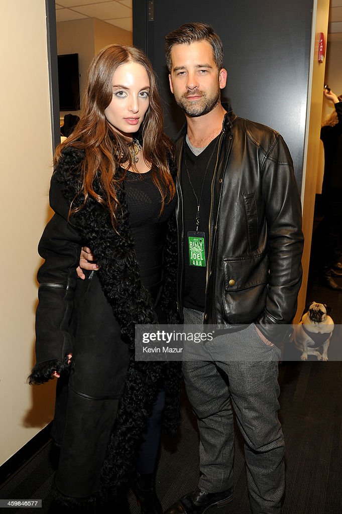Alexa Ray Joel (L) and Ryan Gleason pose backstage at the Billy Joel New Year's Eve Concert at the Barclays Center of Brooklyn on December 31, 2013 in New York City.