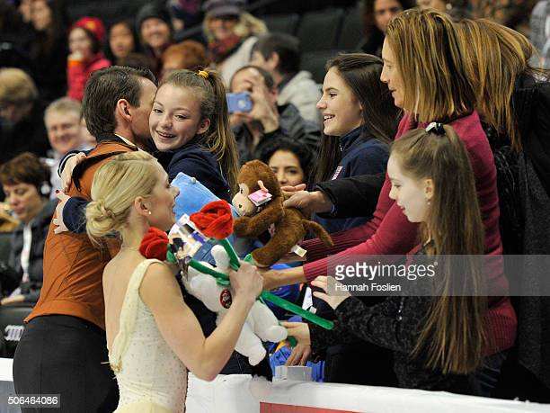 Alexa Scimeca and Christopher Knierim receive hugs and gifts from fans after competing in the Pairs' Free Skate at the 2016 Prudential US Figure...
