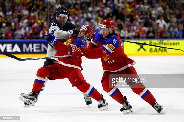 Alexander Barabanov of Russia challenges Julius Honka of Finland during the 2017 IIHF Ice Hockey World Championship Bronze Medal game between Russia...
