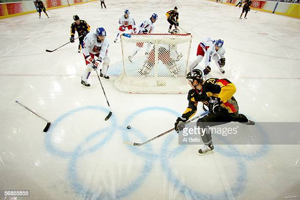 Alexander Barta of Germany brings the puck around the net during the men's ice hockey Preliminary Round Group A match against the Czech Republic on...