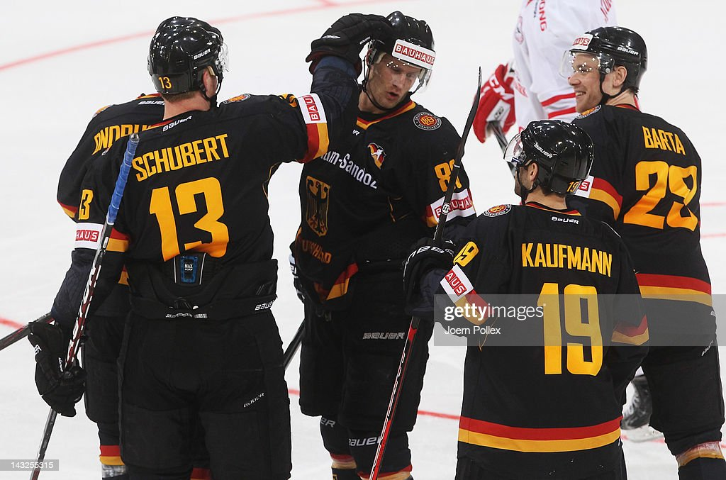 Alexander Barta of Germany celebrates with his team mates after scoring his team's second goal during the international friendly icehockey match...