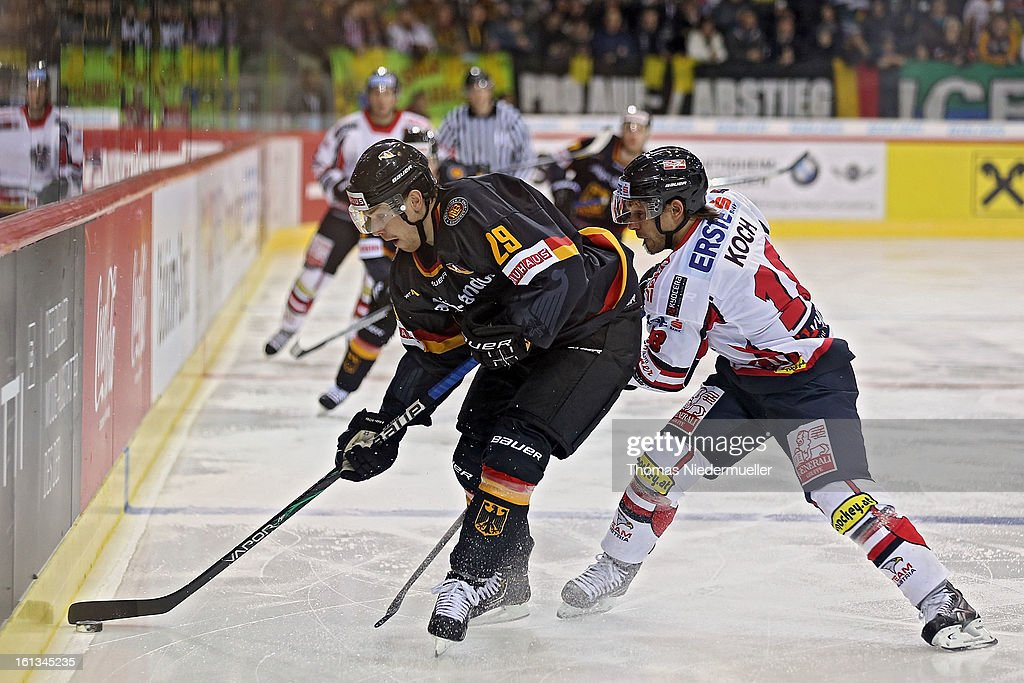 Alexander Barta (L) of Germany fights for the puck with Thomas Koch (R) of Austria during the Olympic Icehockey Qualifier match between Germany and Austria on February 10, 2013 in Bietigheim-Bissingen, Germany.